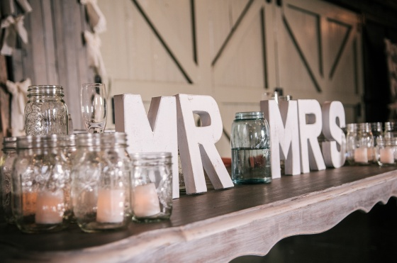 rustic sweetheart table, mason jars with candles, antique table